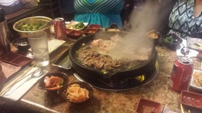 Bulgogi and thin sliced pork belly on the grill.