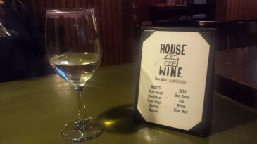 A glass of the Riesling by the wine list